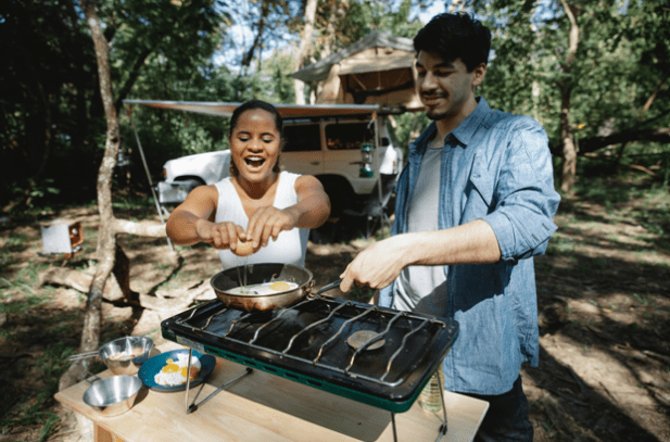 A happy couple enjoying outdoor cooking
